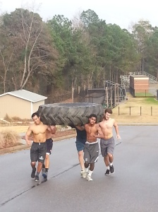 Team Ronpirin on the last leg of the tire carry.